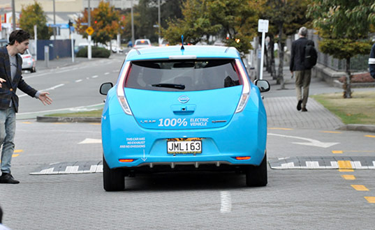 An electric vehicle driving - photo by John Roxborough.